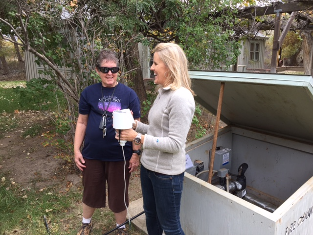 Marian explains the Wellntel system to Sandra Wieser, who has been collecting groundwater information manually at the Kern River Preserve